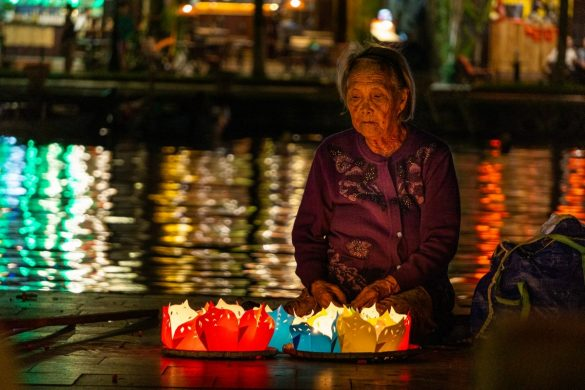 The photo I have chosen for SDG #1 No poverty shows an old lady selling floating candles in Hoi An, Vietnam.